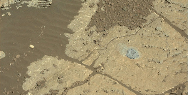 NASA's Curiosity Mars rover used a new drill method to produce a hole on February 26 in a target named Lake Orcadie. The hole marks the first operation of the rover's drill since a motor problem began acting up more than a year ago. Image Credit: NASA/JPL-Caltech/MSSS