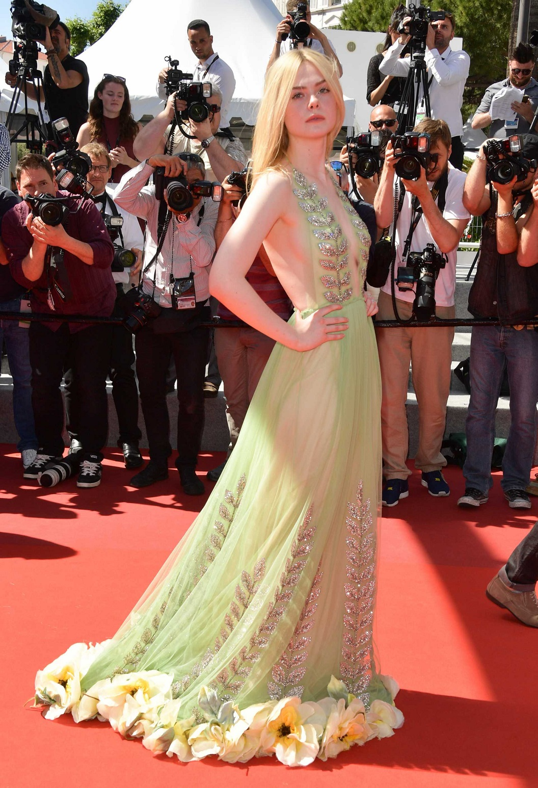 Elle Fanning bares sideboob at the Cannes premiere of 'How To Talk To Girls At Parties'