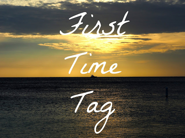 """First Time Tag' text on ocean sunset background"