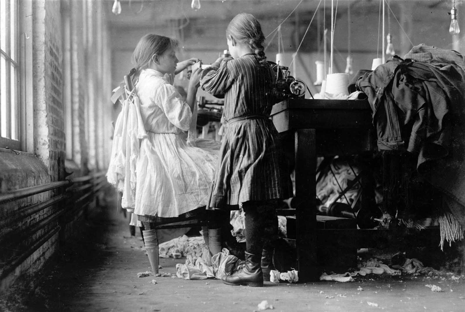 Two young workers, a raveler and a looper, in Loudon Hosiery Mills in Loudon, Tennessee, in December of 1910.
