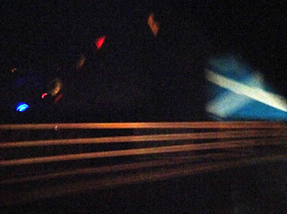 "Shooting past the ""Welcome to Scotland"" sign at about midnight"