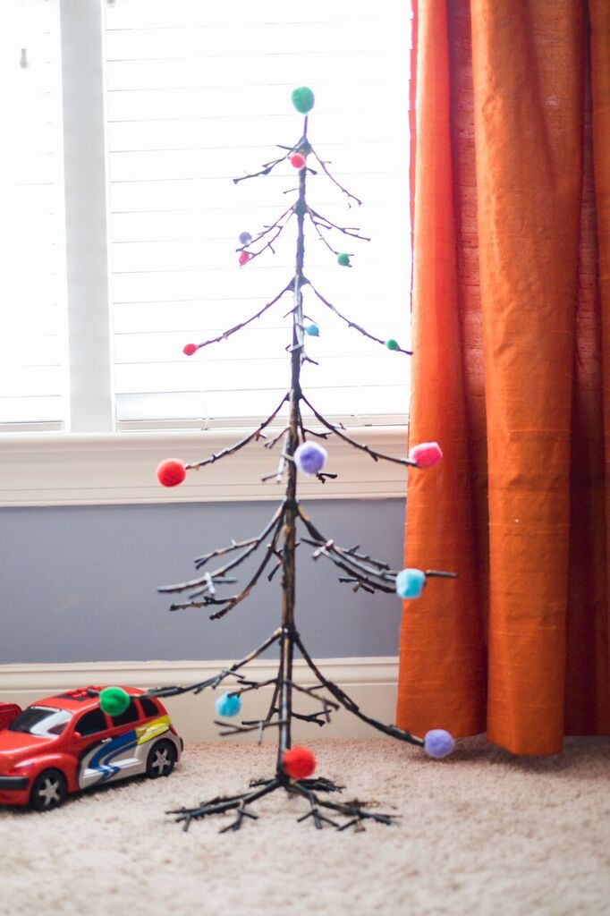 Alternative Christmas tree decorated with pom poms