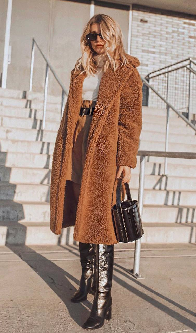 warm winter outfit idea / brown coat + high boots + bag + skirt + white high neck top