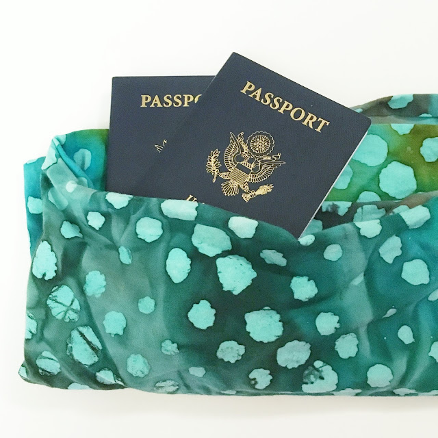 Travel infinity scarf holding two passports