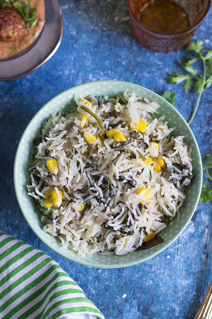 Indian rice pilaf made with corn, spinach and whole spices