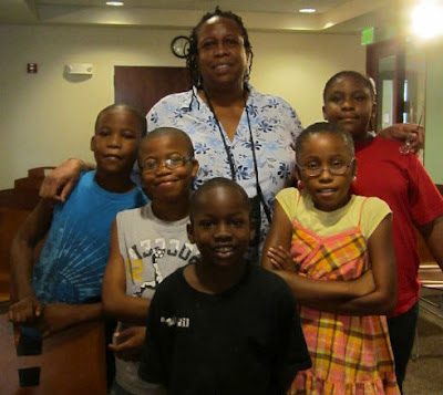 Library employee with group of children