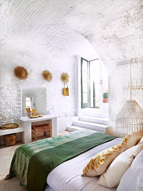 Bedroom with white washed brick walls