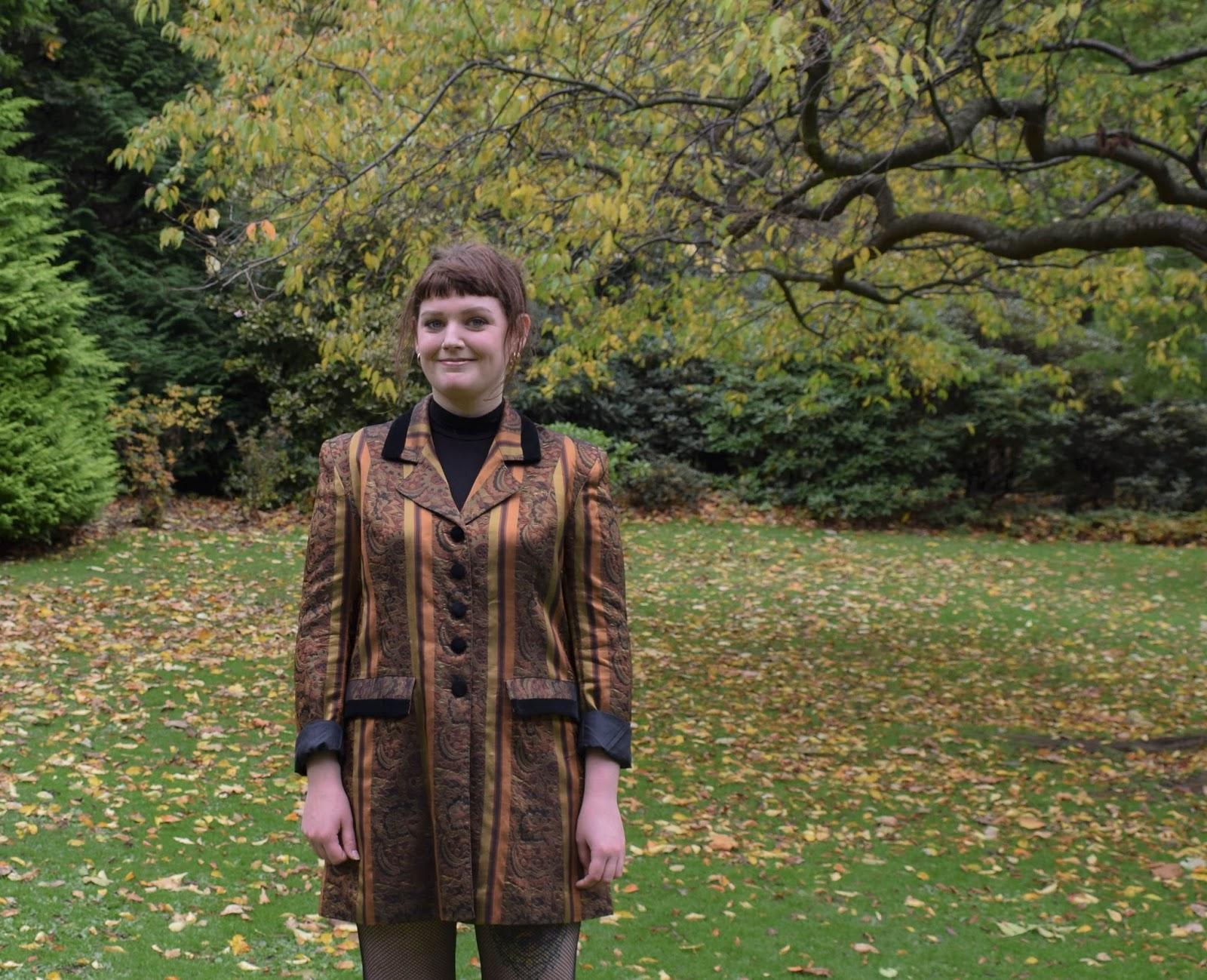 Scottish lifestyle blogger Lauren Aitchison from The Devil Wears Tartan wearing a vintage striped jacket from Rag Trade Vintage
