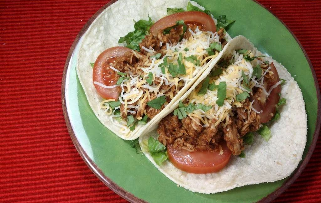 Slow Cooker Mexican Pulled Pork Tacos from Emily Bites found on SlowCookerFromScratch.com