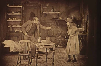 Scene from Broken Blossoms film, by D.W. Griffith