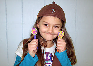"Tessa reluctantly posed with the concentric circle bookmarks she crafted during our ""circle map"" troop meeting."