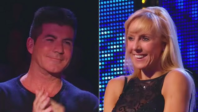 Cowell standing while giving Graham a round of applause.