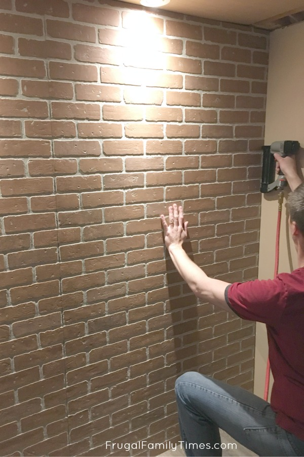 faux brick panels on wall