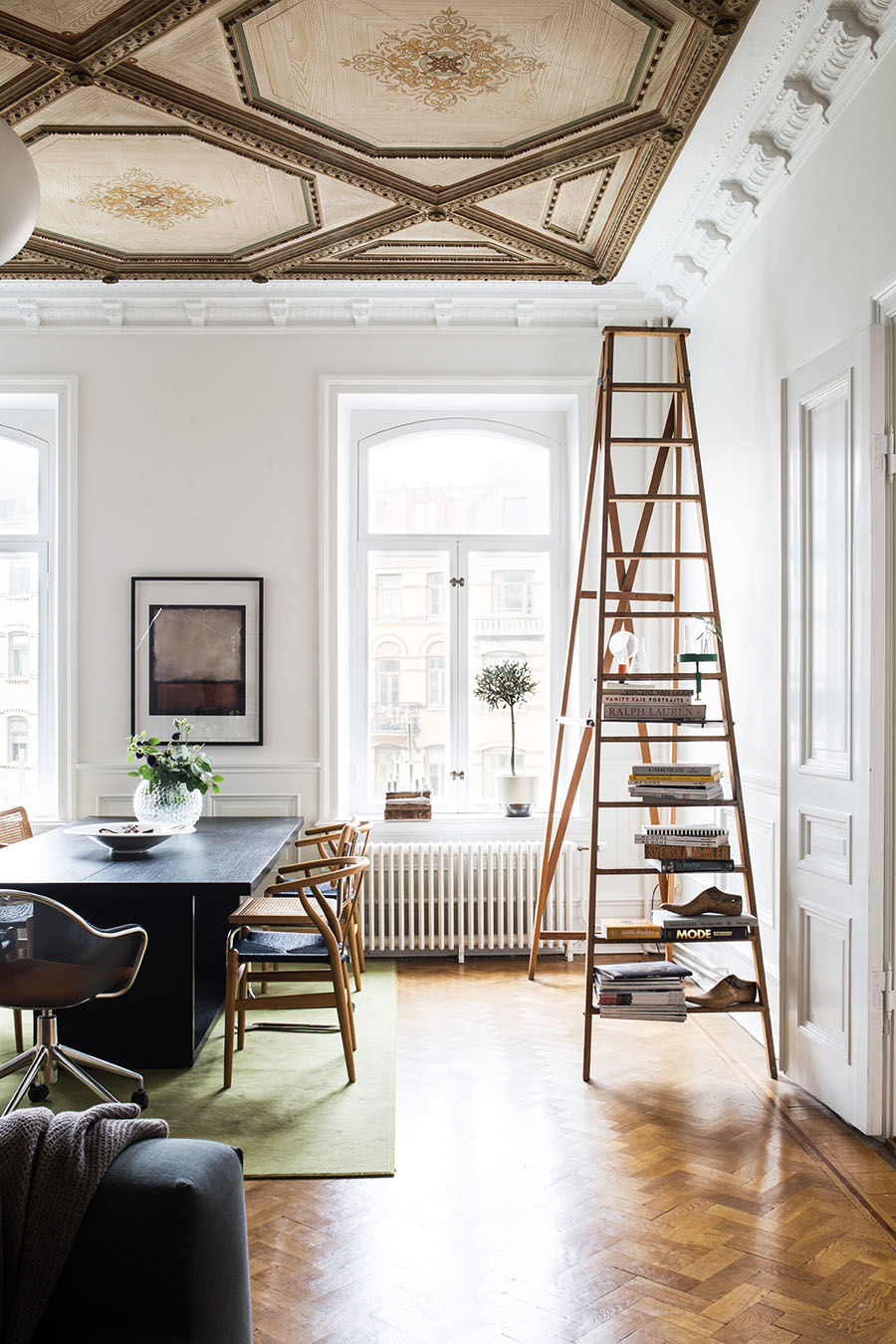 Scandinavian apartment, wegner wishbone chairs, ladder bookshelf, painted ceiling, double doors