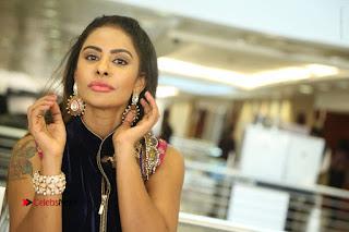Telugu Actress Sri Reddy Mallidi Stills in White Beautiful Dress at Marriage Needs Bridal Fashion Week 2017 Logo Launch  0206.JPG
