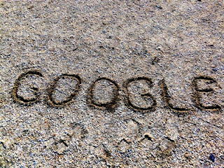 writing google on sand photo
