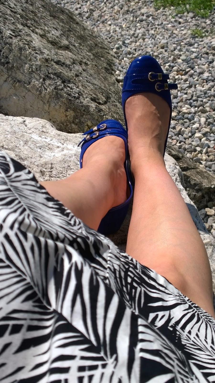 Legs & blue ballet flats