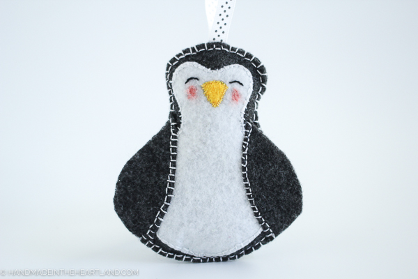 step by step tutorial for how to make a felt penguin ornament
