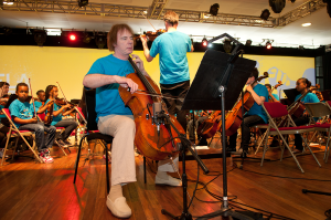 Julian Lloyd Webber with children from In Harmony Lambeth playing at the South Bank Centre