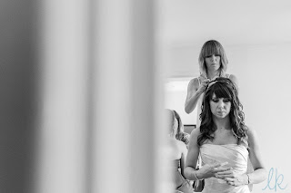 Wedding hairdresser, Louise Chrystal in process of creating a wedding hairstyle