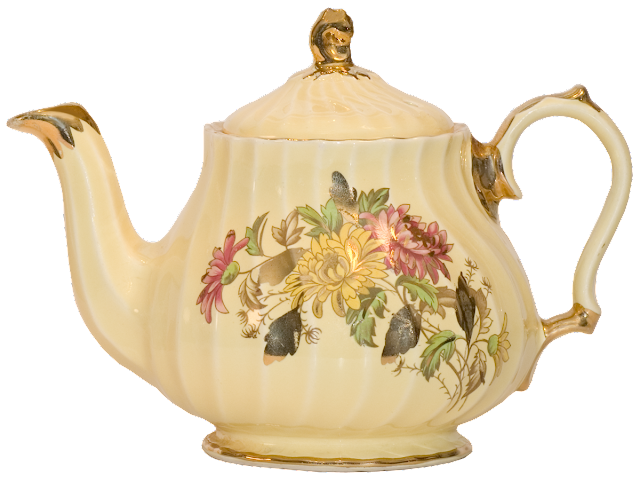A pale yellow china teapot with floral design and gold trim.