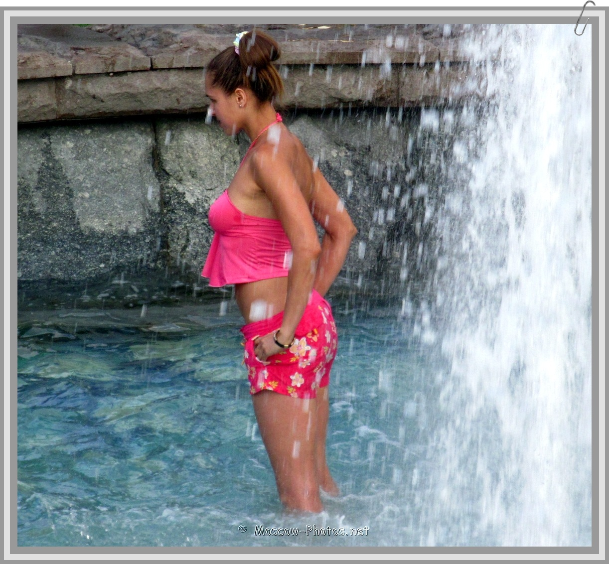 Girl in red bikini at the fountain