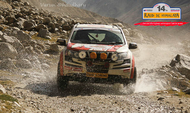 Raid de Himalaya is one of the premier Motorsports event in India, which starts form Shimla, Himachal Pradesh and concluded at Shrinagar (Jammu & Kashmir) after 8 days of action filled days in himalayas. This Photo Journey shares some of the wonderful photographs by Motorsports Photographer Varun Chadhary who has been covering many other Motorsports rallies in India. Let's check out and explore more about Raid De Himalaya action from 2012...Varun has shared lot of wonderful Photo Journeys in past and one of the wonderful Motorsports Photographer in the country. The 14th Maruti Suzuki Raid-de-Himalaya started from Shimla and after that rally/participants traversed a distance of 1800 kms over a span of six days. Raid de Himalaya 2012 was flagged off from Peter Hoff Hotel which is located in Chaura Maidan region of Shimla Town in Himachal Pradesh.The 14th Maruti Suzuki Raid-de-Himalaya was concluded at Leh. Suresh Rana and Parminder Thakur were adjudged the winners of the X-treme 4Wheel category and C.S. Santosh was declared as the winner of the Xtreme 2Wheel categoryK. Prasad and M. Chandrashekhar were declared the winners in the Adventure 4Wheel category. In all, 17 teams in the X-treme 4Wheel category, 40 teams in the 4Wheel Adventure category and 20 bikers could reach the final leg that concluded at Leh.Mahindra XUV500 at 14th Raid de Himalaya 2012 !!!The Moto Xtreme category which is the toughest of the lot is open only to those 4-wheeler drivers who have prior rallying experience and who have competed in one of the earlier editions of the Maruti Suzuki Raid-de-Himalaya. 50 teams participated in the Moto Xtreme 4-wheeler category in this year's event.Mahindra XUV500 splashing out the water on Himalayan terrains during 14th Raid de Himalaya.KTM Duke Motorbike riding through one of the roughest and tough terrains of Himalayas during 14th Raid De Himalaya 2012...Maruti Jypsy crossing through snow covered hills under shining sun and blue sky on the top. A wonderful Click by Varun Chaudhary during 14th Raid De Himalayas 2012Varun is really keen in clicking biker photographs during these motorsports rallies which is quit opposite to many of the other photographers in this areaRaid de Himalaya terrain includes -  Darcha (3360 mts), Keylong (3440 mts), Leh (3524 mts), Kaza (3650 mts), Dhanka (3894 mts), Losar (4079 mts), Rumtse (4300 mts), Kunzum La (4551 mts), Komik (4587 mts), Pang (4600 mts) & Wari La (5313 mts)The Maruti Suzuki Raid-de-Himalaya usually invites participation in three categories: Moto Xtreme, Adventure Trial and Bike Xtreme categories. The participants are grouped in different categories depending upon their prior experience, endurance levels and expertise in handling the escalating difficulty levelsShiny RED Gypsy surrounded by snow covered hills and bright blue sky during 14th Raid de Himalayas 2012 !!On the final ceremony, Mayank Pareek, Chief Operating Officer, Marketing and Sales, Maruti Suzuki, said, 'It was a tough and perilous journey and the winners showed great acumen, stamina and dexterity. This year, we had undertaken a number of extra safety measures like putting in service a helicopter to ensure timely help to rallyists in case of emergencies.' Raid de Himalaya is a test of a competitor's dexterity in handling rough roads, uncertain and extreme weather conditions and the strength and endurance of his vehicle