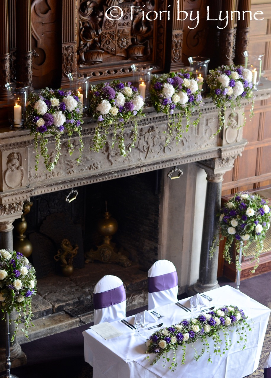 Wedding flowers blog hannah and stuarts classic purple and white rhinefield house all set up for the wedding breakfast with a long and low for the top table using white roses purple lisianthus and pink gypsophila with thecheapjerseys Choice Image