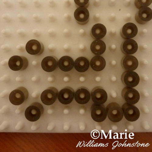 The bottom of the key pattern shape beads beaded peg board