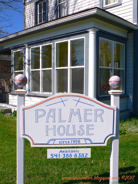 Full view of faux marble globes on Palmer House sign, Globes designed by Tina M. Welter