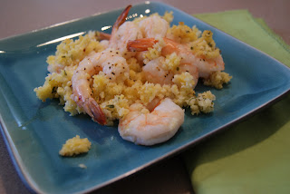 Baked shrimp scampi served with rice on a blue plate.