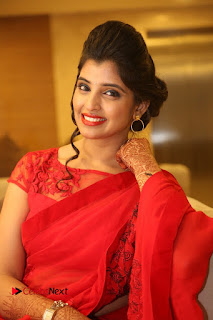 Shyamala Stills in Red Saree at Okkadochadu Movie Audio Launch ~ Bollywood and South Indian Cinema Actress Exclusive Picture Galleries