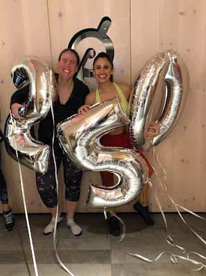"""Photo of me and JJ holding giant silver balloons that say """"250"""""""