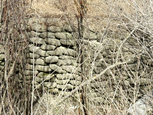 retaining wall of concrete bags