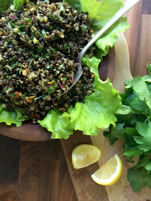 Wild rice lentil salad is a great salad for summer. It's tossed with a fragrant vinaigrette that's seasoned with coriander, cumin, turmeric and cinnamon and sprinkled with currants and toasted almonds. Wild rice lentil salad is great with fish and chicken but also works on its own as a meatless meal.