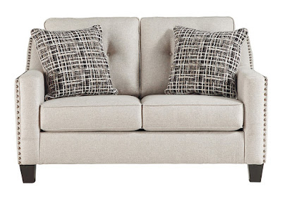 tufted gray loveseat