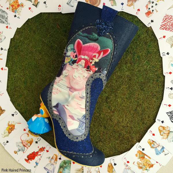 right boot showing Alice tea party scene on grass background