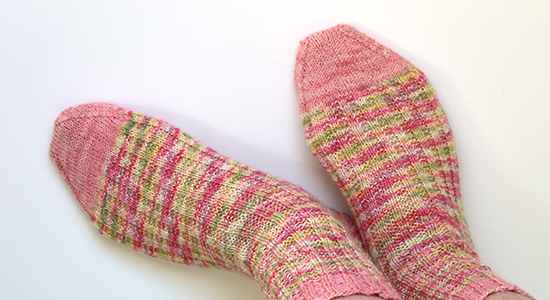 Pink and Multi-Colored Pastel Hand Knit Socks on Feet