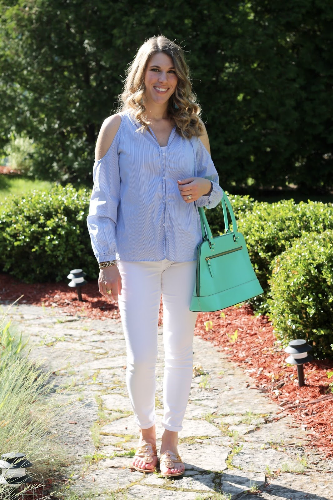 blue striped cold shoulder blouse, white jeans, Jack Rogers sandals, green Kate Spade bag, second trimester maternity spring outfit