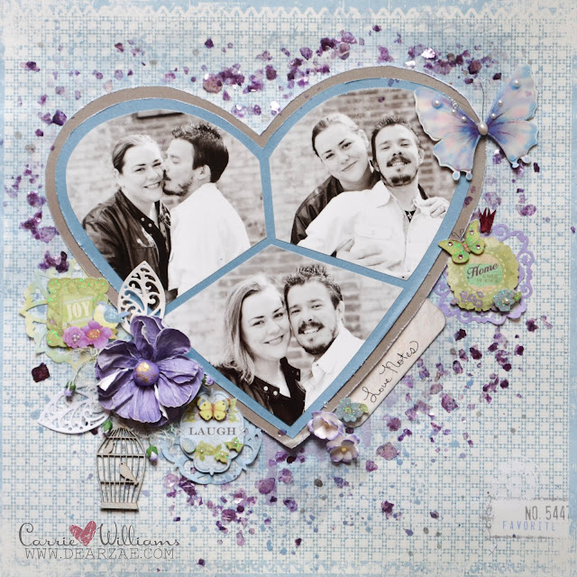Guest design team layout in blue and purple, mosaic heart design using multiple photos with watercolors and mica flakes with wood bird cage and phrase stickers.