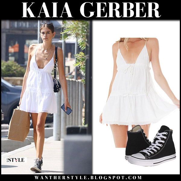 Kaia Gerber in white mini dress and black sneakers converse model street style august 24