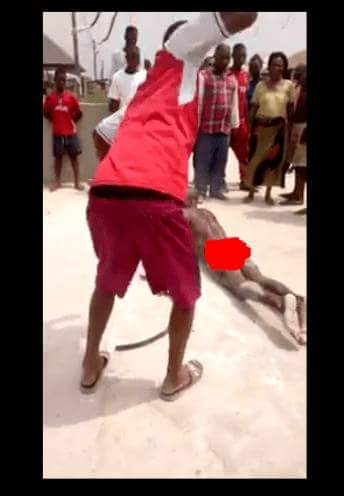 Photos: Man stripped naked and subjected to severe flogging before an angry crowd for raping 10-year-old girl in Bayelsa