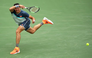 Raonic rallies to reach Indian Wells fourth round