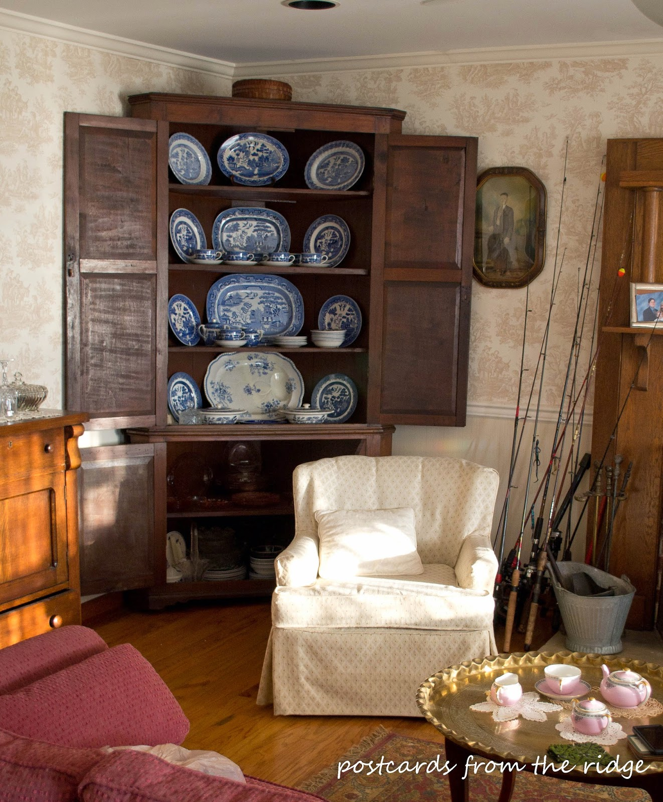 Love the blue and white dishes in the antique corner cabinet.