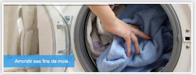 putting laundry in a washing machine