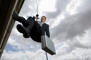 Spy rappelling with suitcase