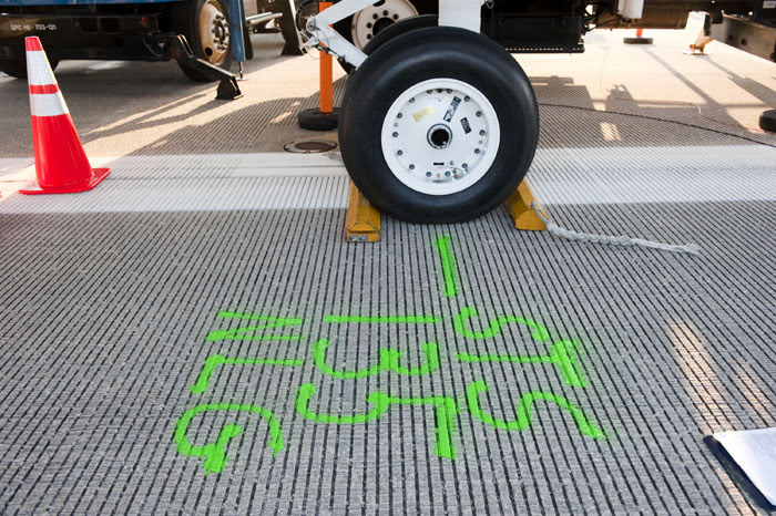 At KSC's Shuttle Landing Facility, the location where Atlantis' nose landing gear came to a final stop is marked for historical purposes, on July 21, 2011.