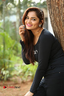 Actress Aswini Latest Stills in Black Denim Jeans  0052.JPG