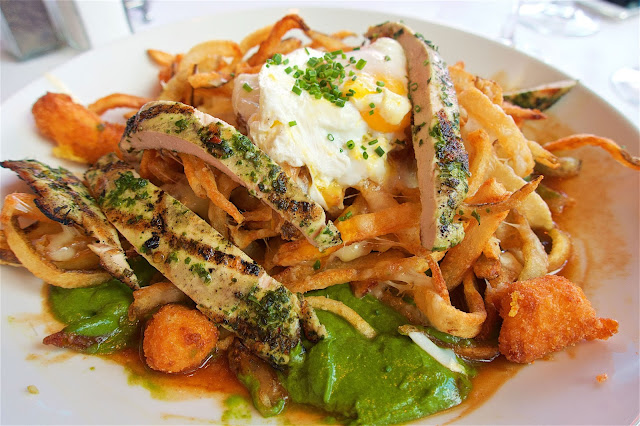 Chicken Poutine - Hand-cut fries, grilled chicken, jarlsberg cheese, fried cheese curds, parsley-arugula jus topped with a poached egg - from Mon Ami Gabi at Paris Hotel in Las Vegas.