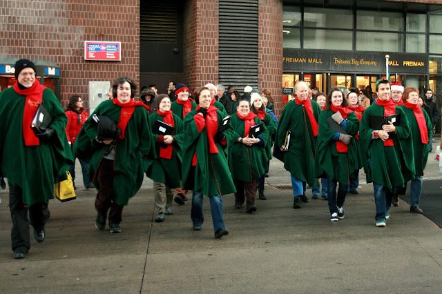 The Stairwell Carollers race across the street to carol in Byward Market